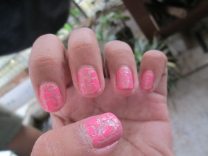 Nails coated with Very Me Graffiti Pink